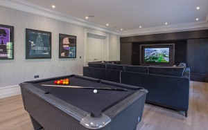 luxury games room with pool table