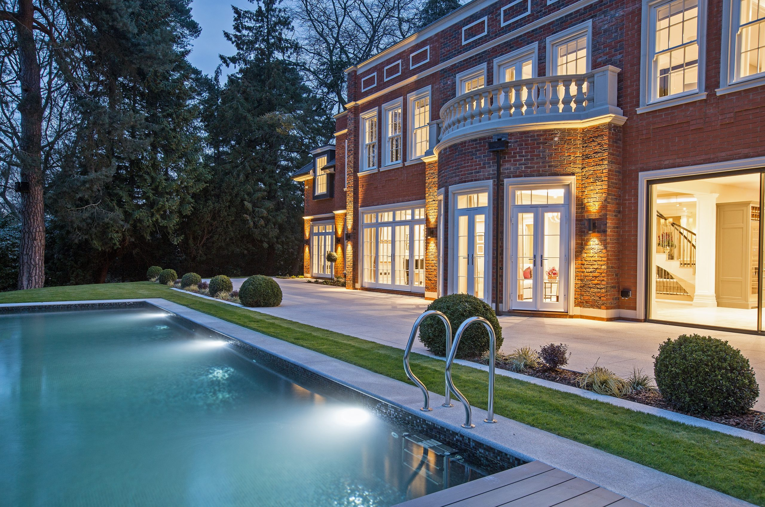 luxury home with outdoor pool