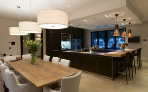black kitchen with dining space
